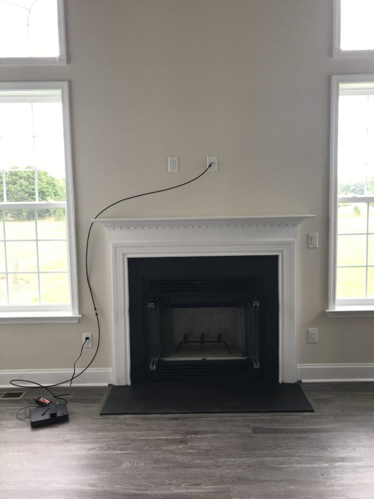 How to safely mount a  TV above the fireplace - TV wiring above the mantle