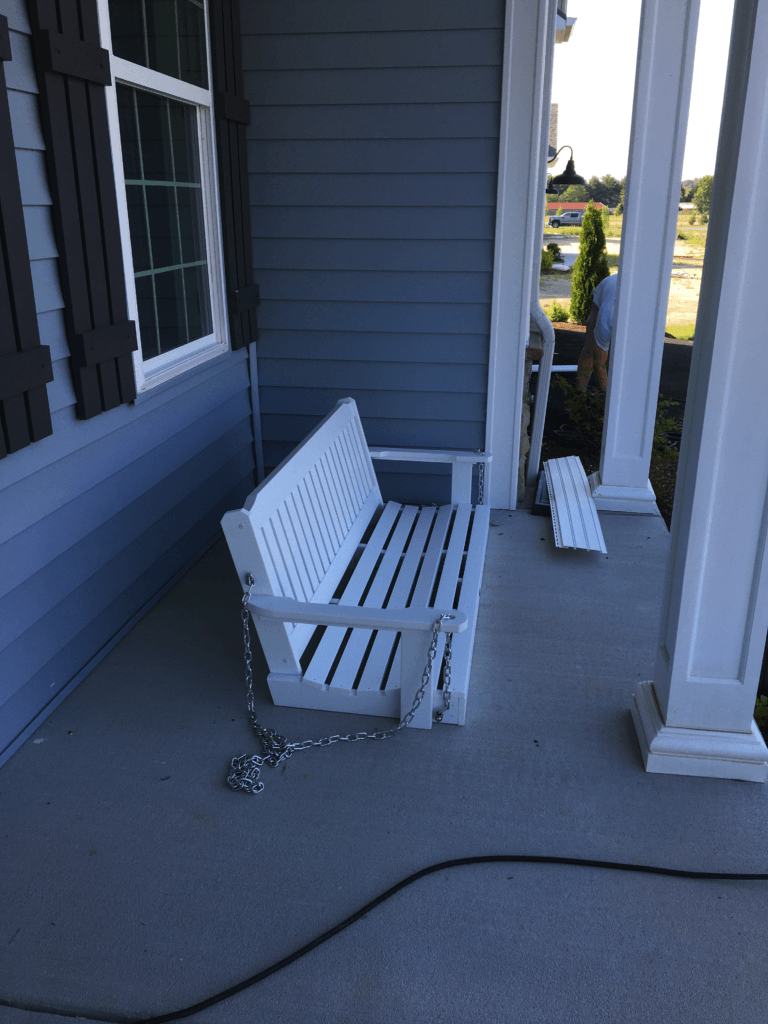 Porch bottom with unattached swing