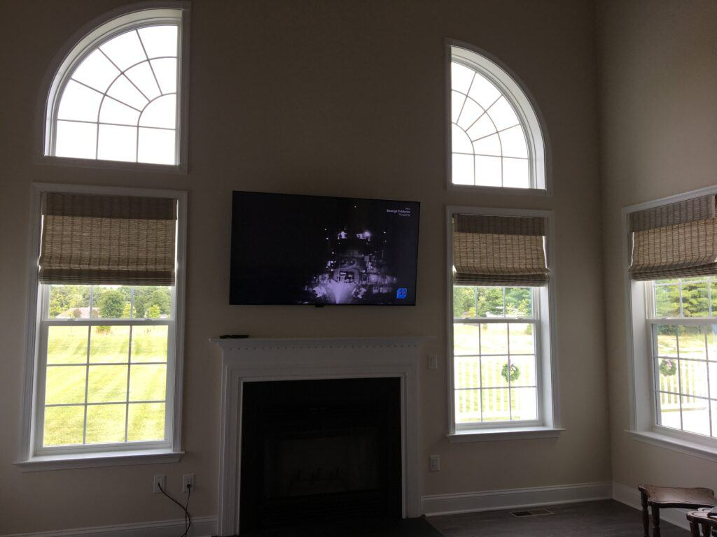How to transport a 65 inch tv - TV mounted above the fireplace