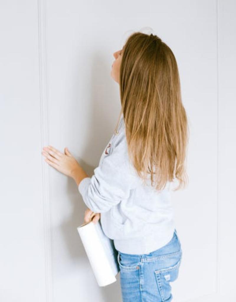 Women Inspecting wall