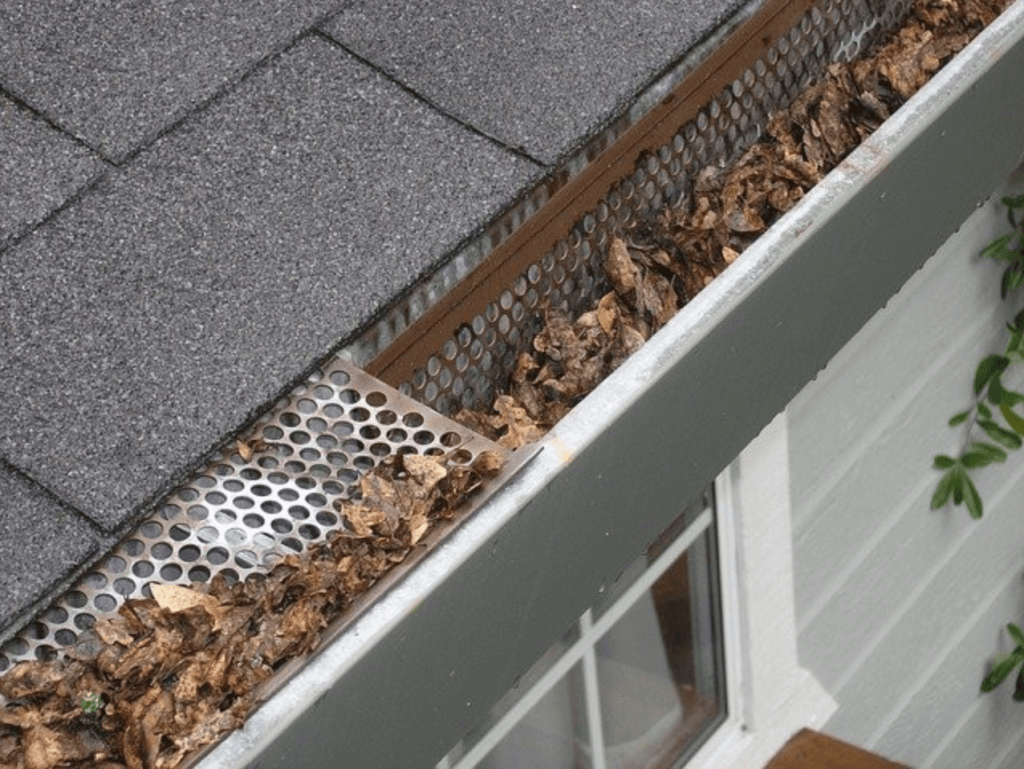 This Is What Happens If You Don't Clean Out Your Gutters - Gutters with many leaves