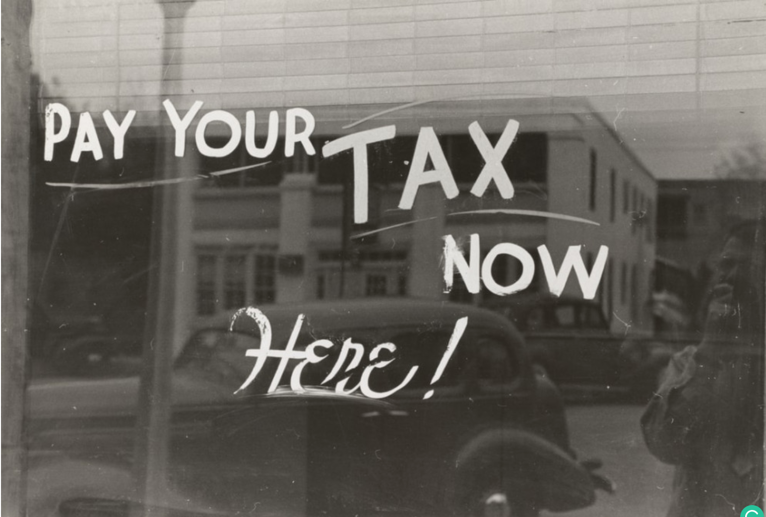 Why Do Homeowners Have to Pay Property Taxes? - Pay your tax now here sign