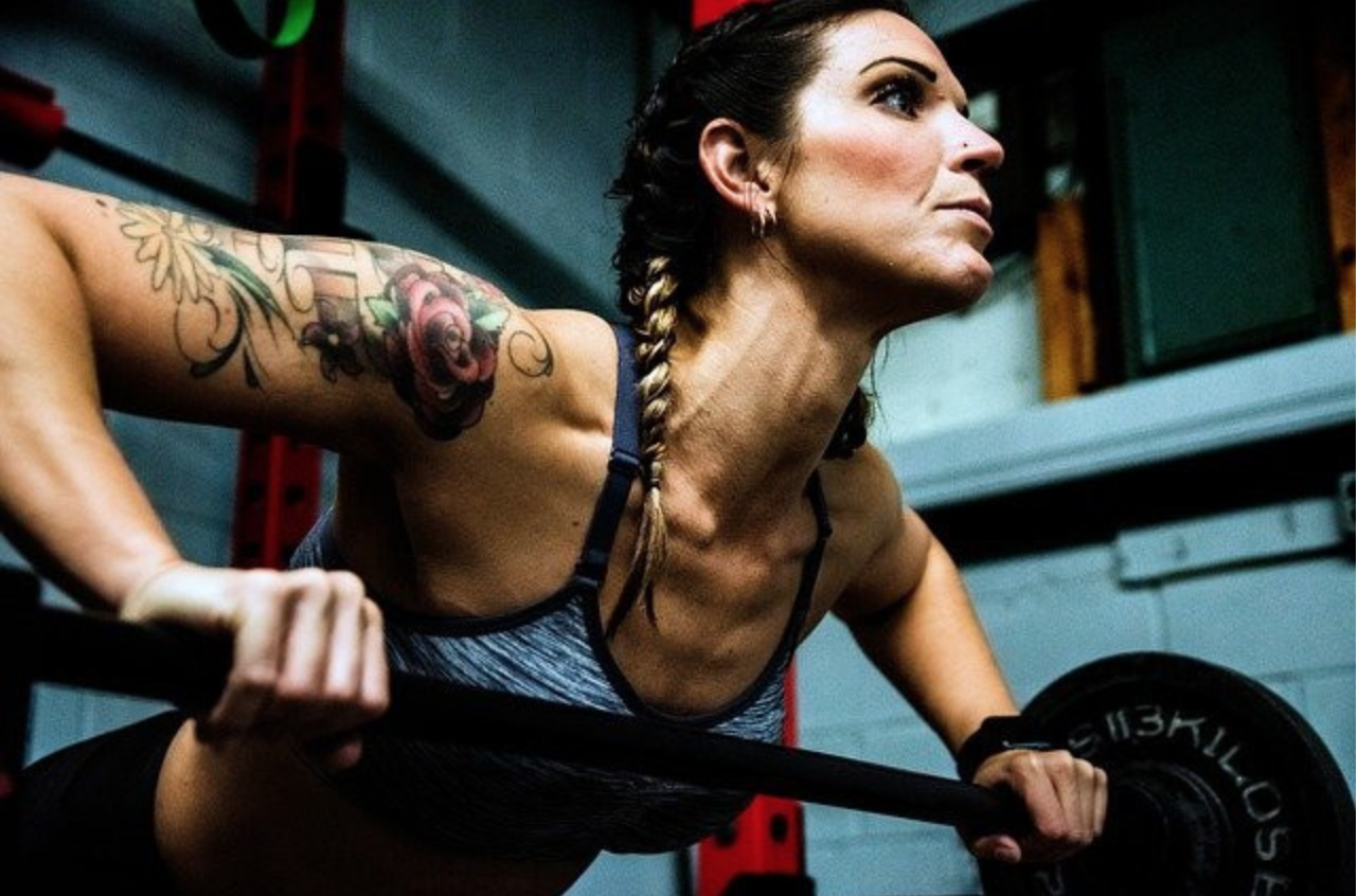 Is It Better to Invest in Home Gym Equipment or Join a Gym? - Woman exercising