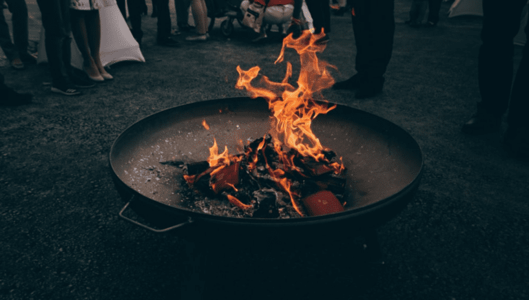 10 Things to Consider Before Building a Backyard Fire Pit - Fire Pit with People
