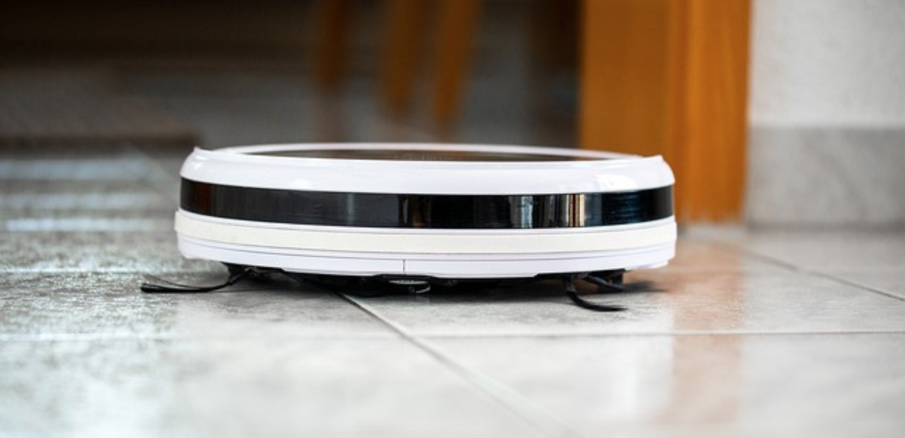 Do Robot Vacuum Cleaners Really Work? - Robot vacuum cleaner cleaning the floor
