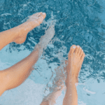 Is a Swimming Pool Worth the Money? - Feet on on swimming pool water