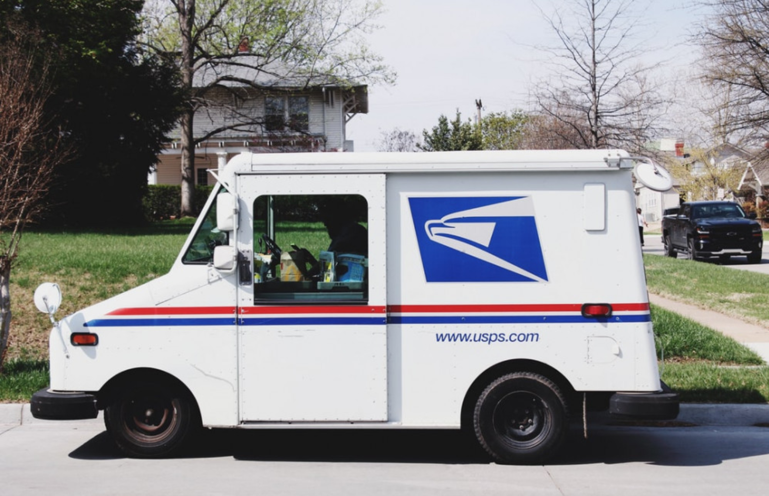 How Do I Find Out What Time My Mail Comes? - USPS Mail Carrier Van