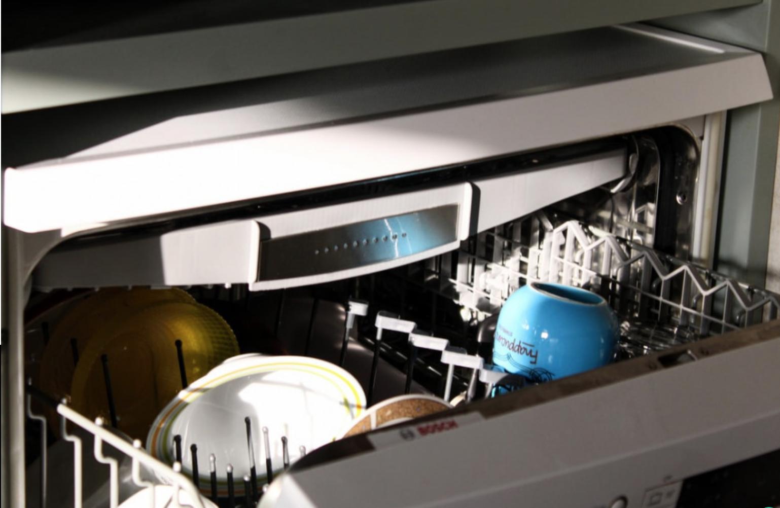 Do Dishwashers Heat the Water? - Open dishwasher